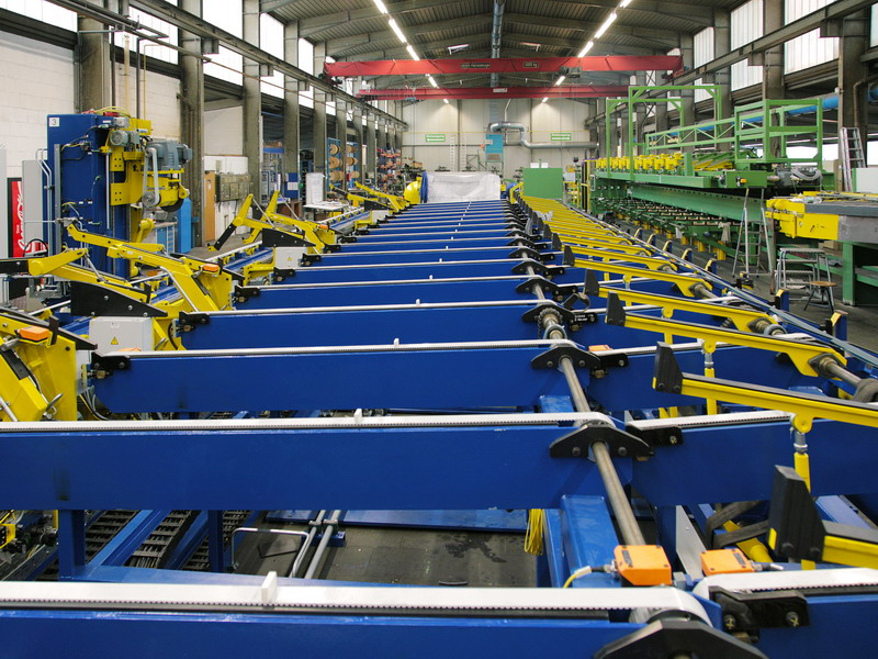 Production line for testing, sawing, chamfering and packing of tubes